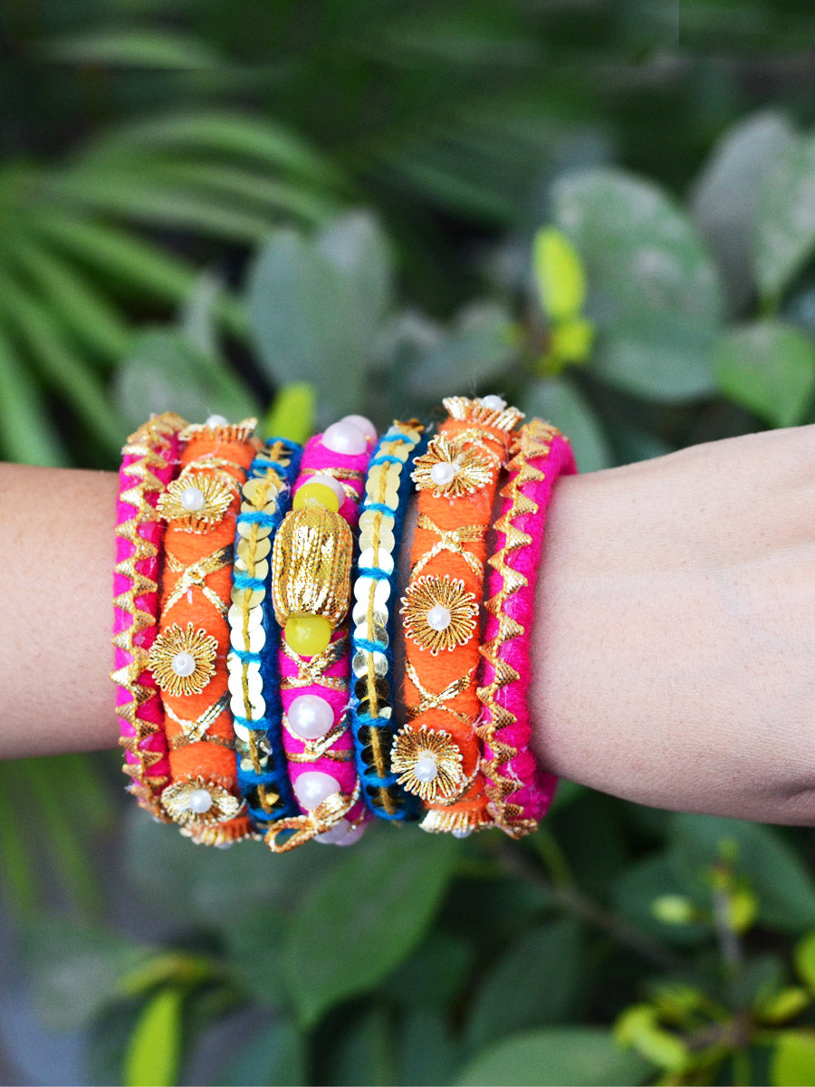 Dholki Gota Bangles, a set of 7 exclusive handcrafted designer gota work bangles from our latest collection of hand embroidered bangles for women online.
