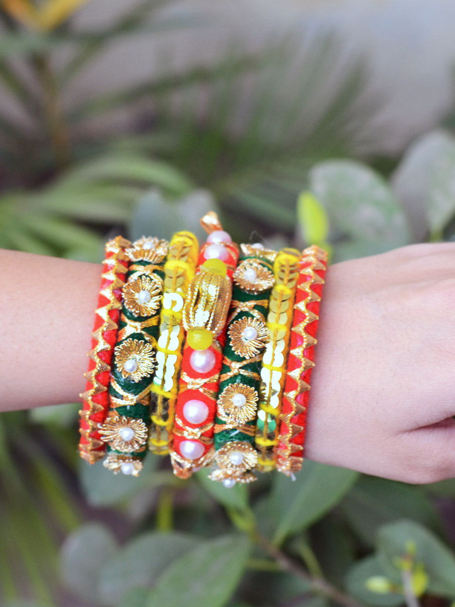 Dholki Gota Bangles, a set of 7 exclusive handcrafted designer gota work bangles from our latest collection of hand embroidered bangles for women.