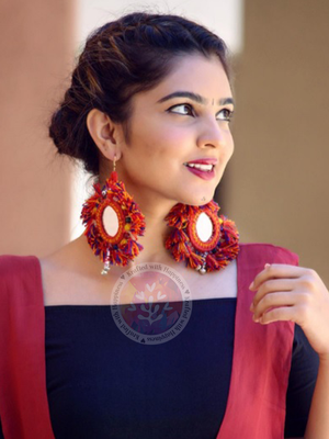 You're my Sun Earrings, a beautiful handmade hand embroidered earring with mirror and tassel from our designer collection of earrings for women online.