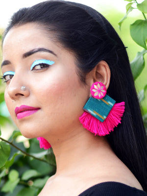 Nida Shine Earrings, a handcrafted unique coin earring with handmade ikat base and mirror and tassel detailing from our bohemian collection of earrings for women.