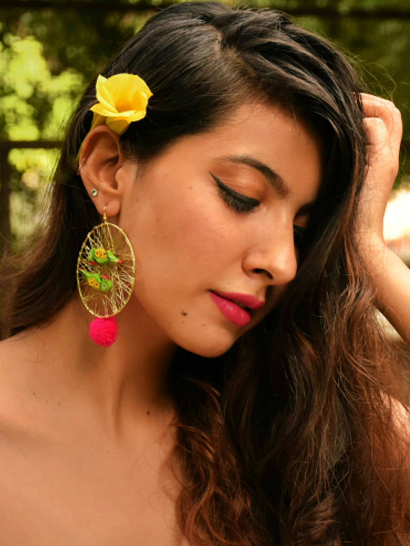 Parrot Paradise, an exclusive designer Indian pom pom earring with hand painted parrots from our designer collection of earrings for women.