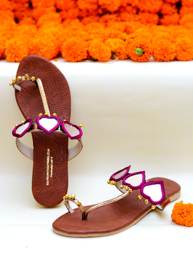 Raani Noor Kolhapuris, a beautifully hand crafted ethnic kohlapuri footwear with mirror and ghungroo detailing to kick in the bohemian look and feel.