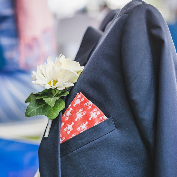 Should you wear a boutonnière and a pocket square at your wedding?