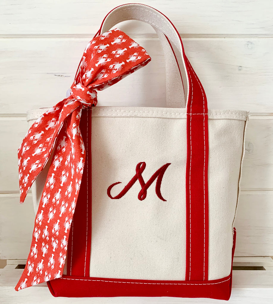 L.L. Bean Boat and Tote Bag with The Maine Square Retro Ribbon tied on it