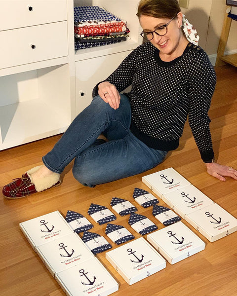 Laura the designer at The Maine Square showing the gift boxes that pocket squares are packaged in for groomsmen gifts