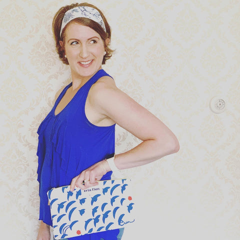 Laura Lynn Michaud CEO at The Maine Square carrying an Erin Flett Zipper Clutch