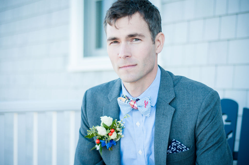 Pocket square worn with boutonnière
