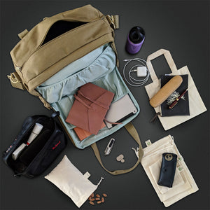 dera design organic diaper bag with suggested contents