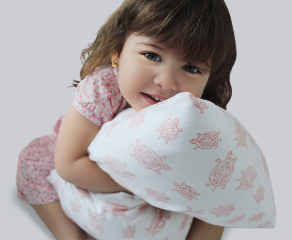 pink turtle pillowcase with girl toddler
