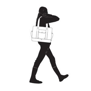 Silhouette walking with Dera Design diaper bag