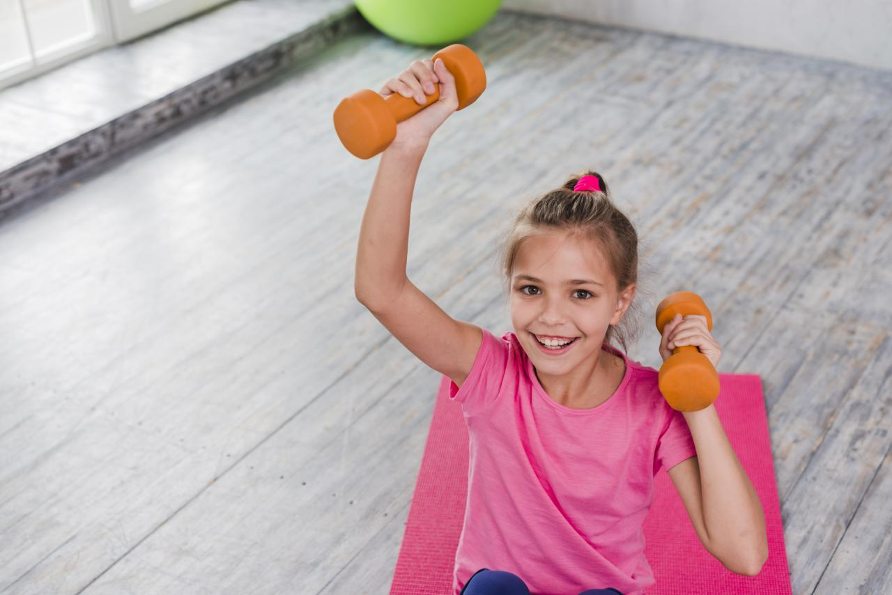 Girl exercising with light wheight