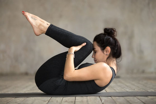 knees to chest for back pain