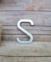 silver metal letter