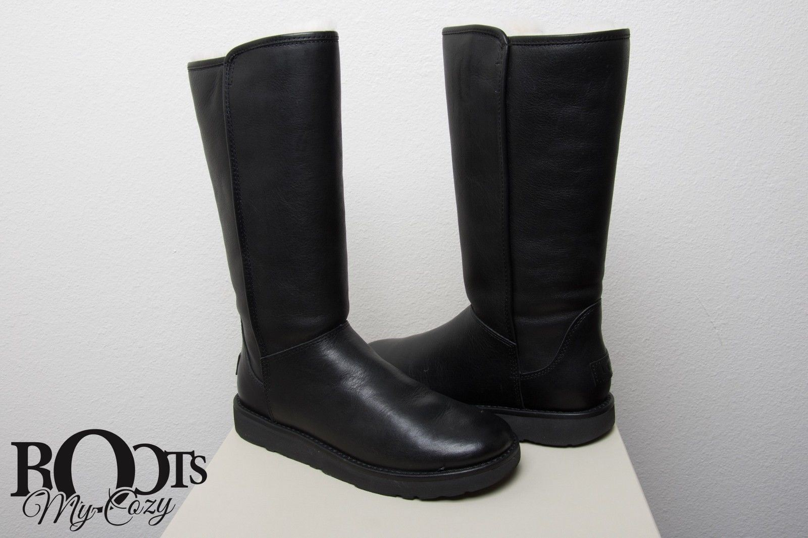 a72c2dda41a UGG Abree II Tall Leather Nero Boots
