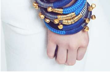 Close up of woman wearing multiple summer rope bracelets