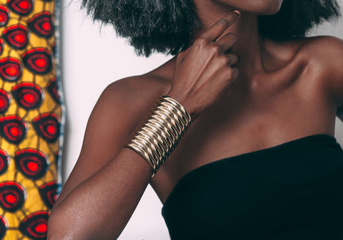 Close up of woman posing with Gold Ndebele Cuff