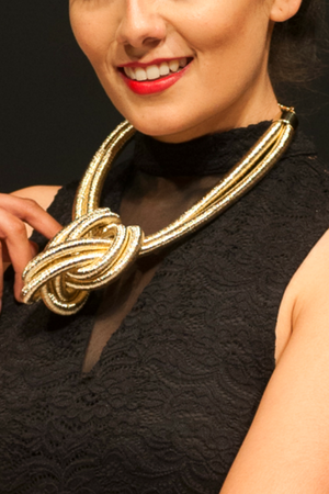 Close-up of woman posing with Gold Rope Knot necklace