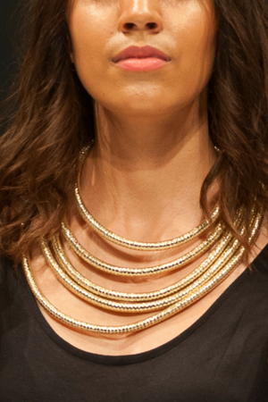 Close up of woman posing with the Gold Rope Necklace