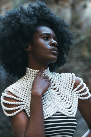 Close up of woman posing with the Pearl Cleopatra Necklace