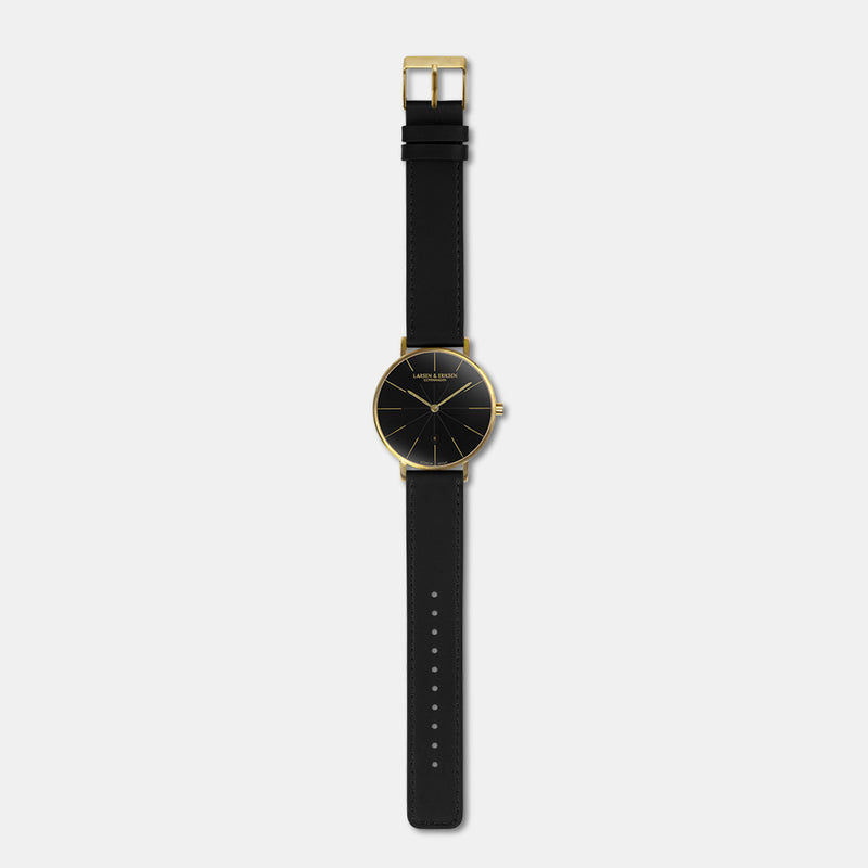 LARSEN&ERIKSEN Værk gold and black watch with black leather strap