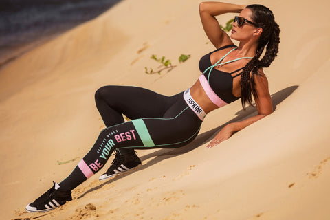 girl laying in the desert wearing black fitness leggings and black fitness top