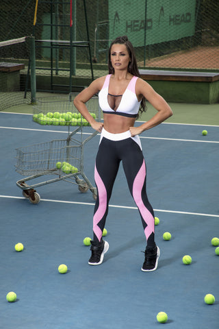 fitness woman standing on the tennis court with her hands on her hips with a fierce look on her face