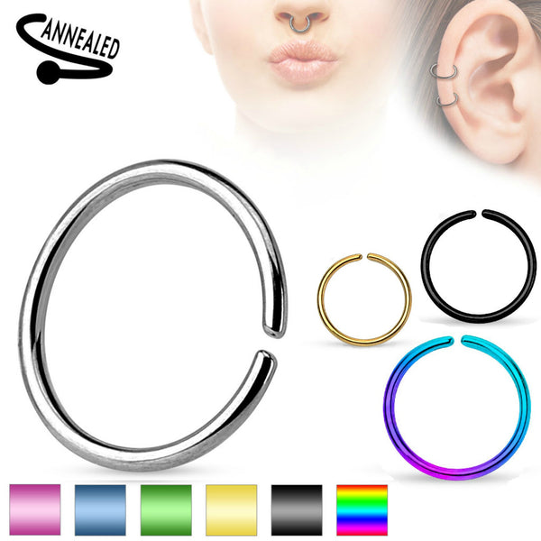 Word annealed in left corner and product models in right corner showing this ring worn in a septum and helix piercing. A round seamless ring shown in steel, blue, green. gold, black, and rainbow color boxes.