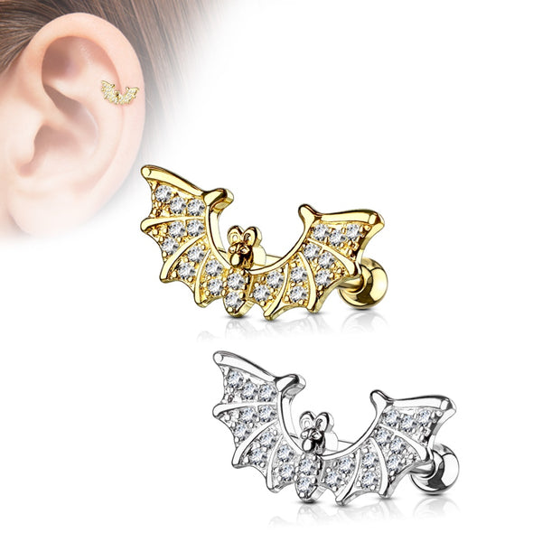 Bat wing cartilage paved with clear gems in steel or gold. Also shows the bat in  a helix piercing in the top left corner.