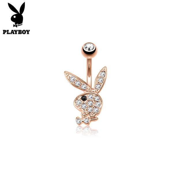 A rose gold, non-dangle, belly ring, with a Playboy logo design. The playboy logo is filled with clear gems and a black gem eye.