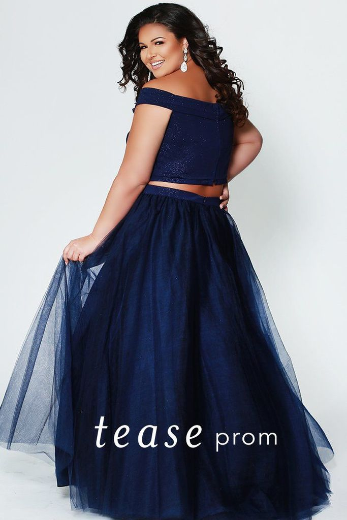 Glitter the night away in this Indigo plus size prom dress