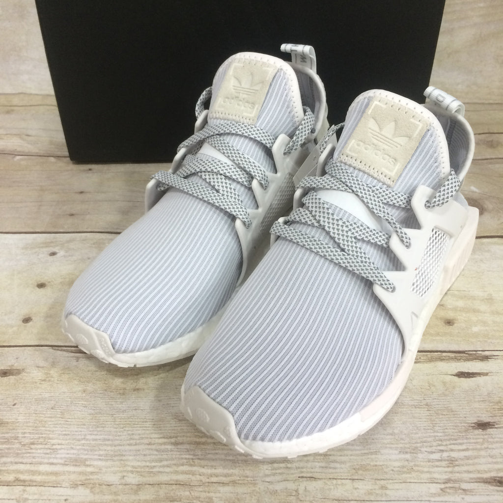 real vs fake adidas yeezy boost 350 adidas nmd xr1 bb3684
