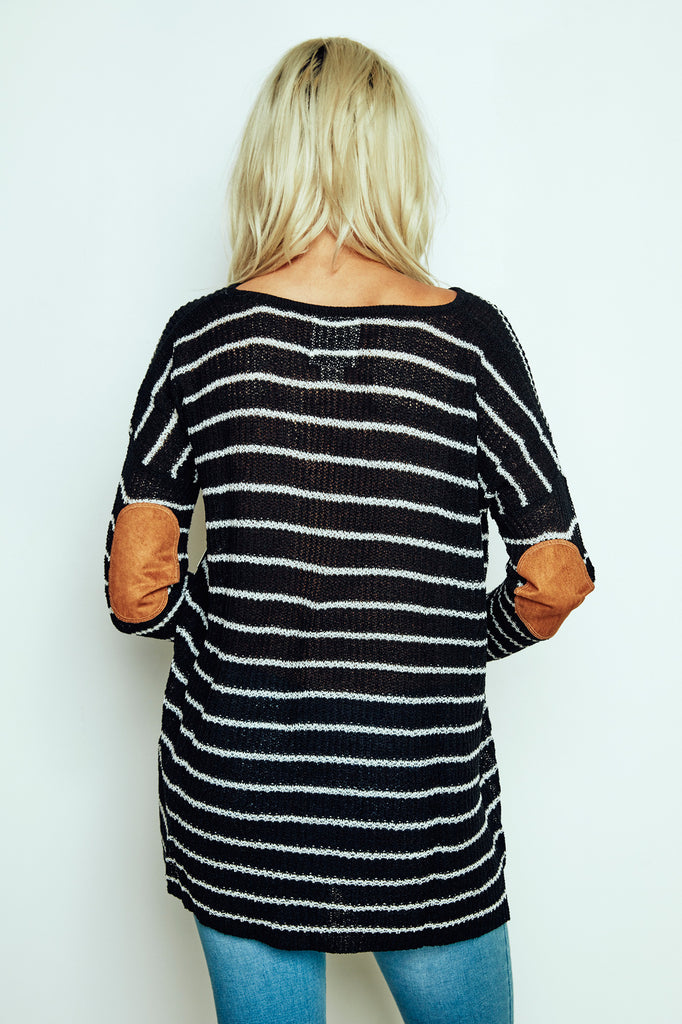 STRIPED OVERSIZED KNIT SWEATER