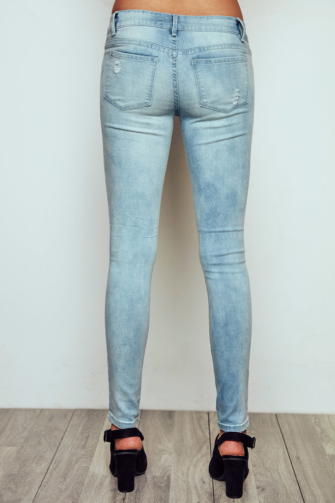 DISTRESSED BRAZIL LOW RISE BLEACHED SKINNY JEGGING