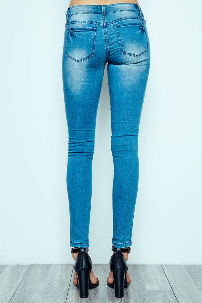 BRAZIL LOW RISE MEDIUM BLUE DISTRESSED JEGGING
