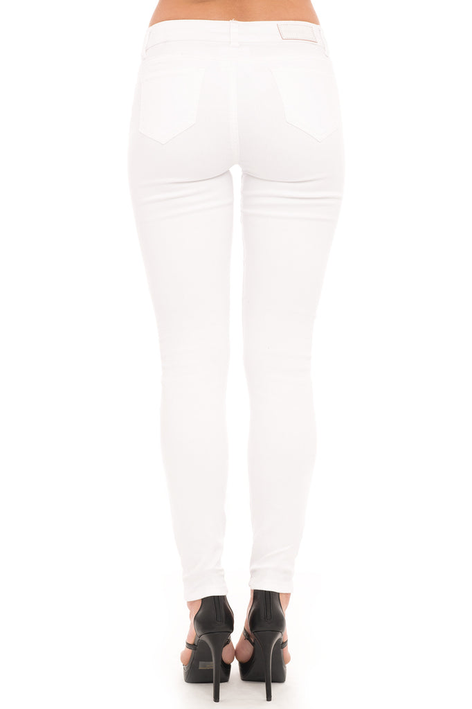 DESTROYED WHITE LOW RISE SKINNY JEAN
