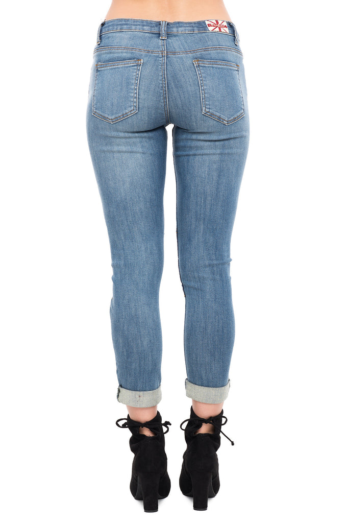 MACHINE BRAND SKINNY JEANS WITH RIPS AND A KNEE PATCH
