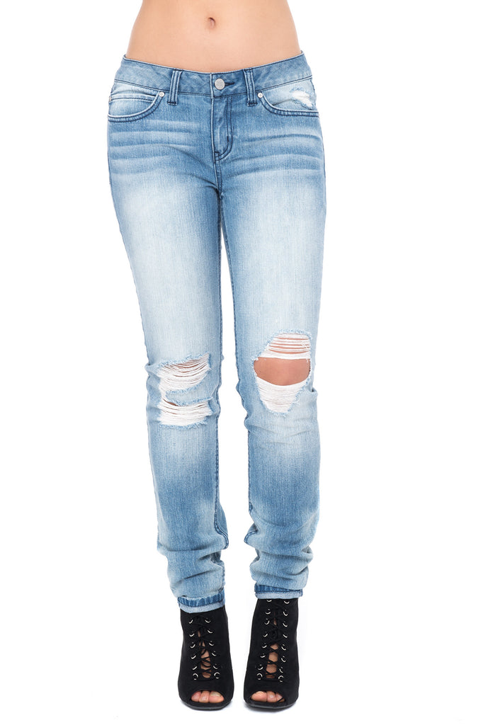 LOW RISE RIPPED BLEACHED SKINNY JEAN