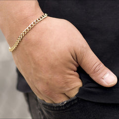 Gold Plated 5mm Gold Cuban Link Bracelet worn by a guy as his bracelet