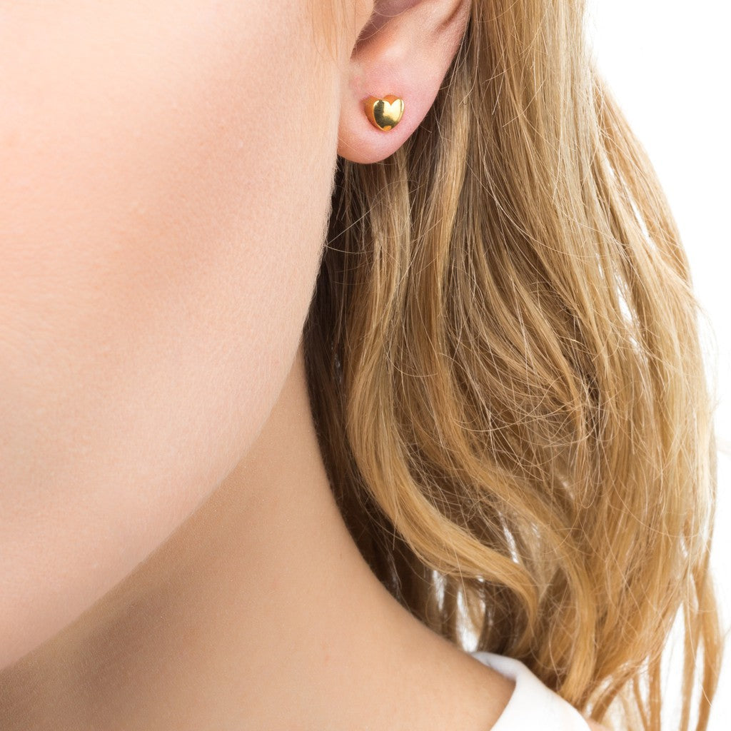 Woman wearing Gold Plated Heart Studs