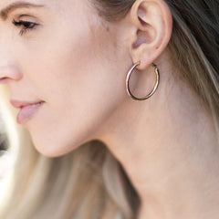 Woman wearing Gold Plated Hoop Earrings, Medium