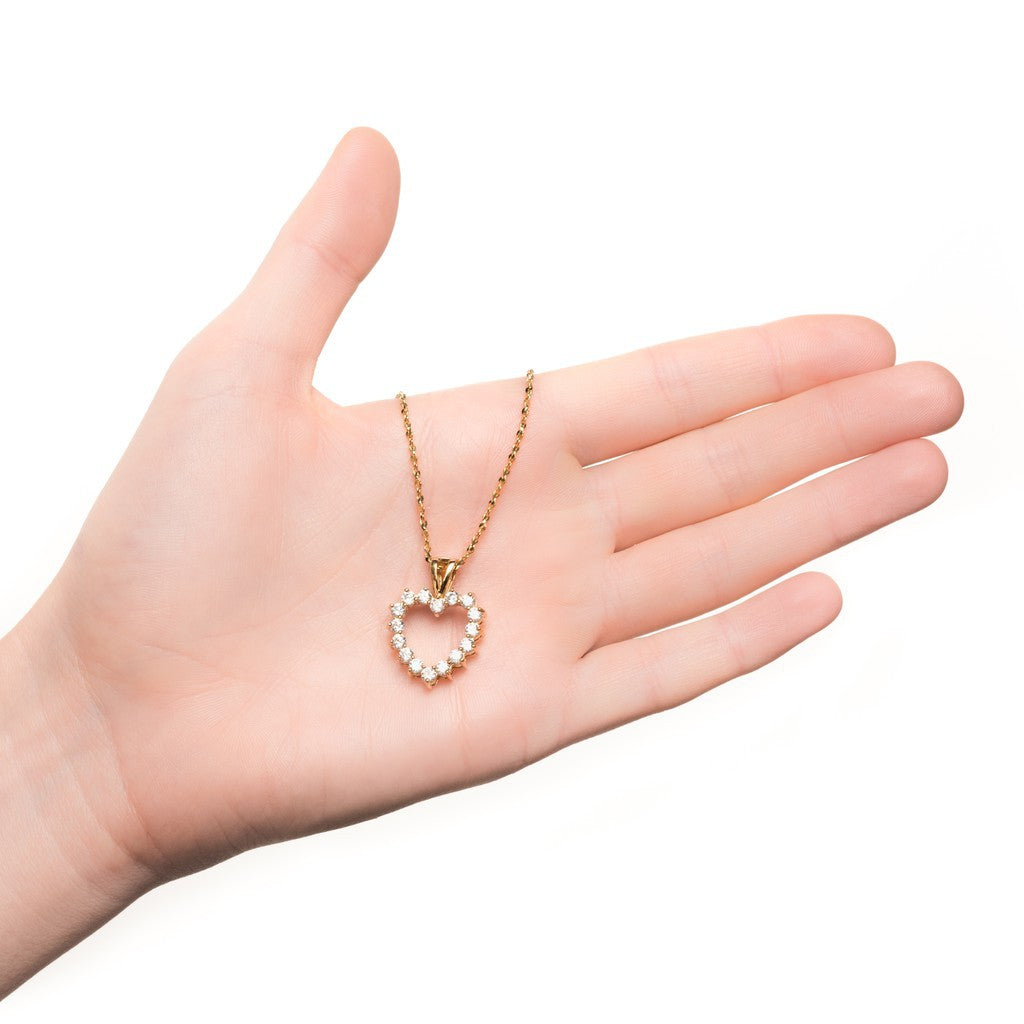 Gold Plated Heart Necklace Open Cubic Zirconia Pendant in hand