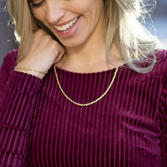 Gold Plated 3mm Rope Chain worn by a woman in maroon as her necklace