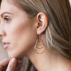 Woman wearing Gold Plated Triple Hoops Earrings