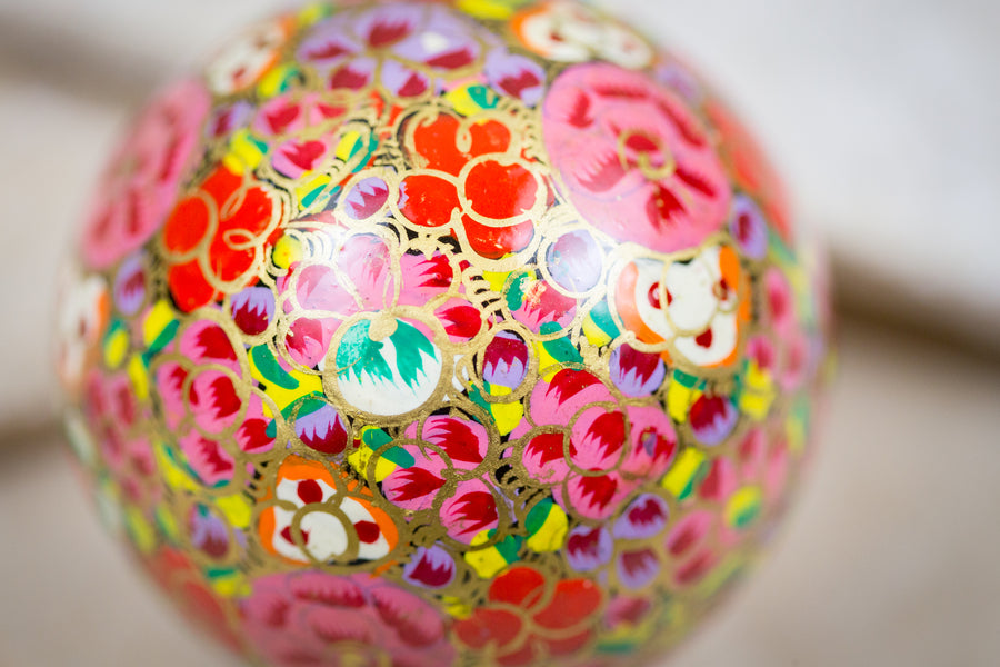 Handmade and hand painted decorative ornament pink red green