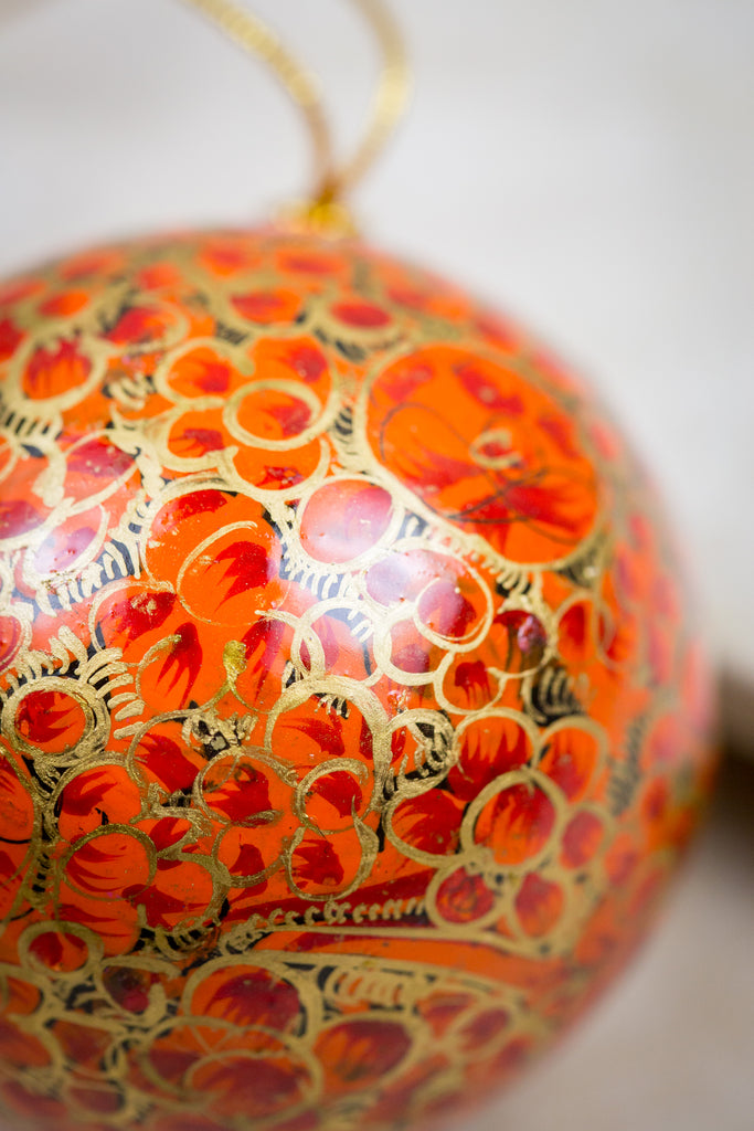 Handmade and hand painted decorative ornament orange red gold