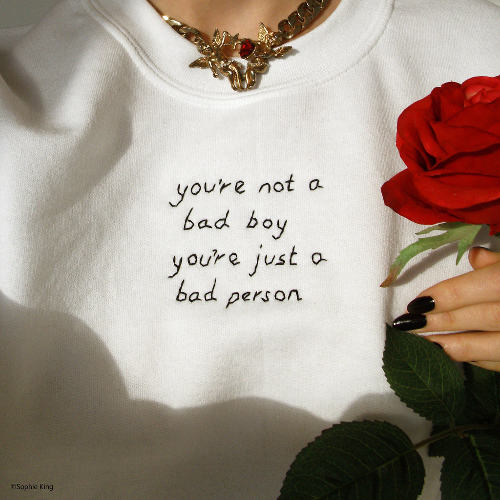 """You're not a bad boy, you're just a bad person"" hand embroidered unisex sweater sophie king"