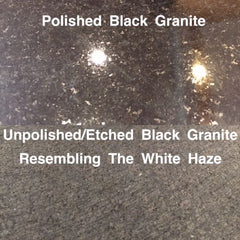 An image that shows a piece of granite, one side polished and the other damaged. The damaged side has been etched.