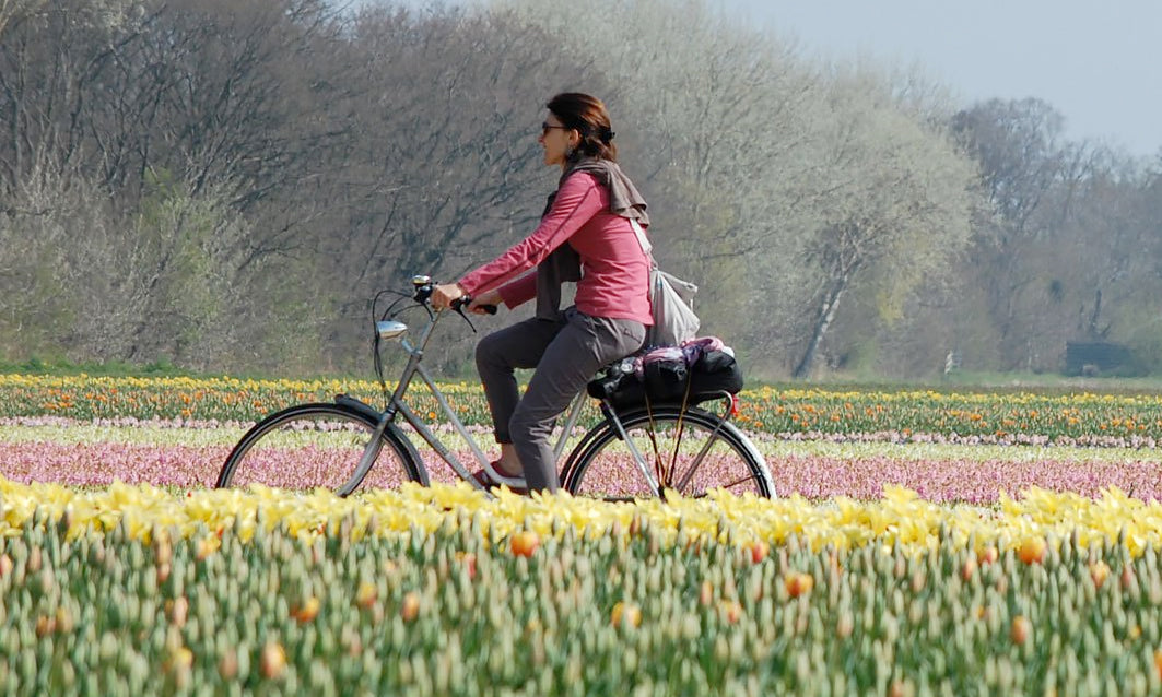 Farmer Gracy employee on a bicycle
