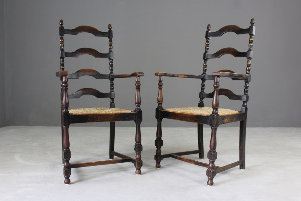 Pair Oak Ladderback Carver Chairs