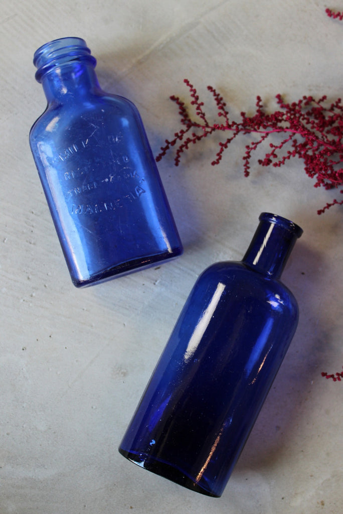 Pair Blue Glass Bottles